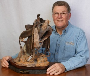Darwin Dower with a Wooden Saddle Sculpture