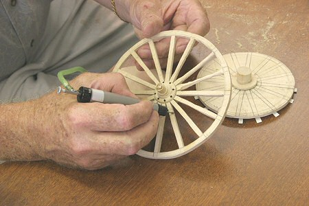 Darwin carves the Wheel for the Handcart