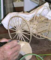 Darwin Carving a Wooden Handcart Sculpture