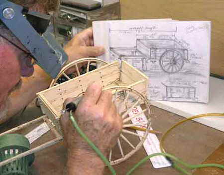 Darwin Carving a Wooden Handcart Sculpture