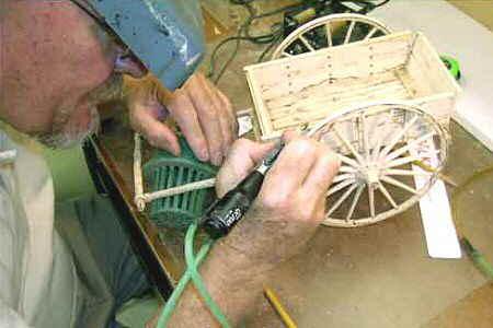Darwin Carving a Wooden Sculpture